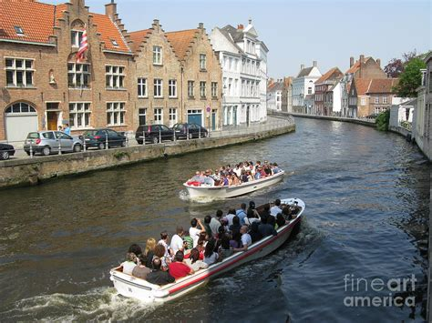 boat tour in bruges boat tours in brugge belgium photograph by ausra