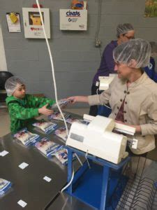mussman volunteers to pack meals at feed my starving children