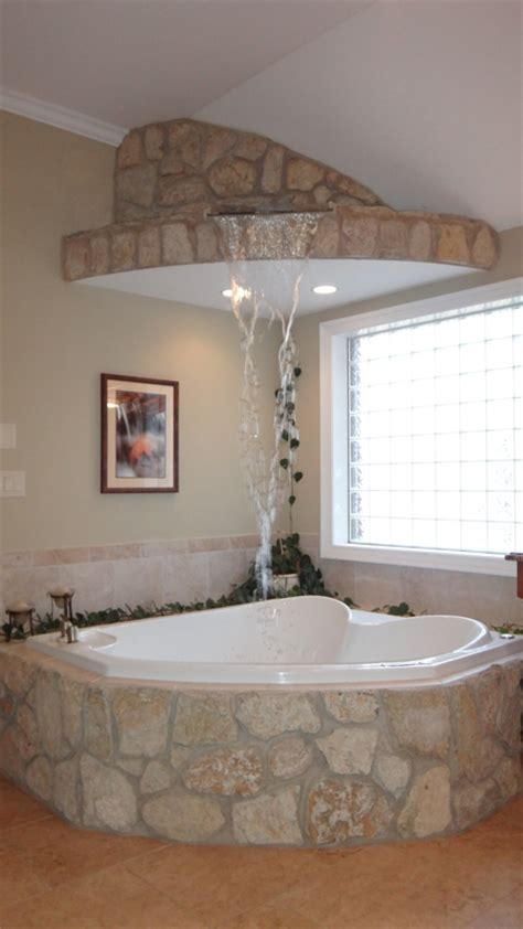bubble jet bathtub master bath stone waterfall feature fills the bubble jet tub from above home