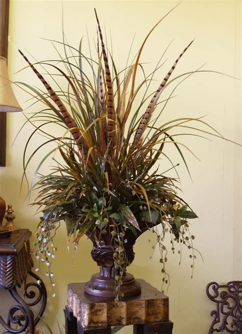 designed by arcadia floral home decor floral design pedestal vase grasses pheasant feathers floral design