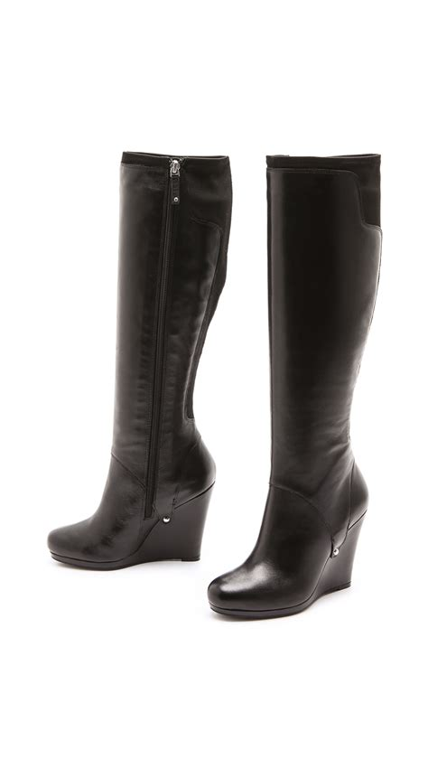 dkny stretch back wedge boots in black lyst