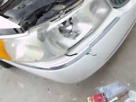 changing a headlight and fixing a bumper on a lincoln
