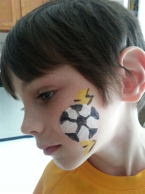 soccer ball with flames boy s face painting by let s soccer ball with lightning bolt face paint pinterest