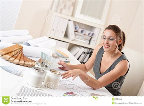 successful interior designer woman at office stock
