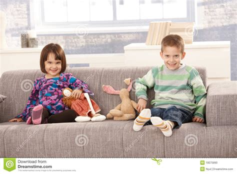 kids on couch happy kids sitting on sofa stock photo image of girl