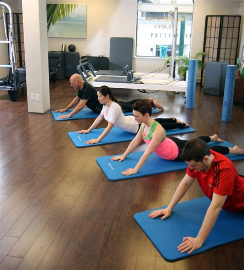 Pilates Mat Class by Top Ten Questions Pilates Mat Or Reformer Classes