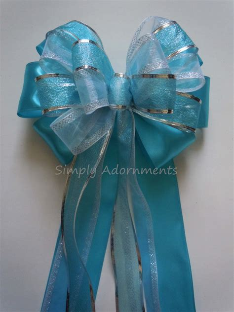 turquoise blue silver wedding bow blue church pew decorations