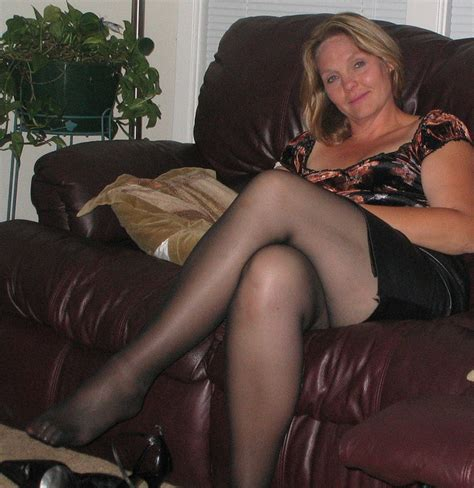 milf sofa sexy long legs and a short leather skirt a photo on