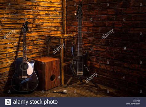 cajon bass and acoustic guitar on wooden stage in pub - Cajon And Acoustic Guitar