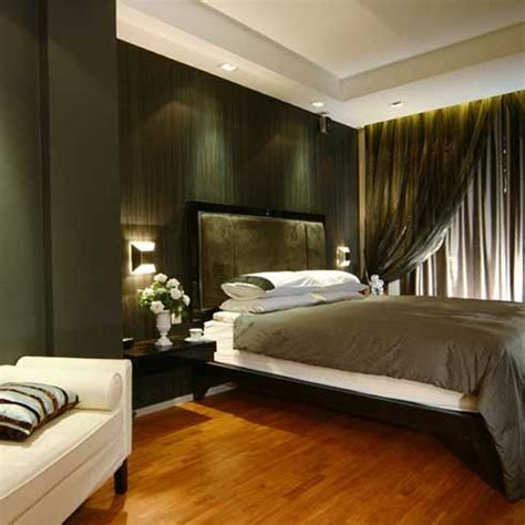 green walls bedroom contemporary bedroom with wood floor gray bed cover and