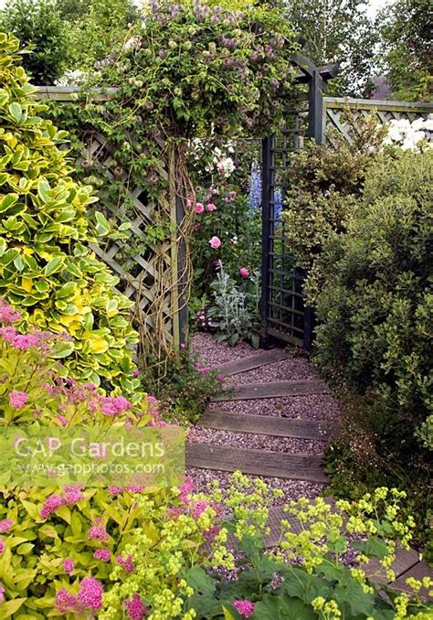 Railway Sleepers Stoke On Trent by Gap Gardens Gravel Path Leading Through Arch In Pretty Secluded Suburban Garden High