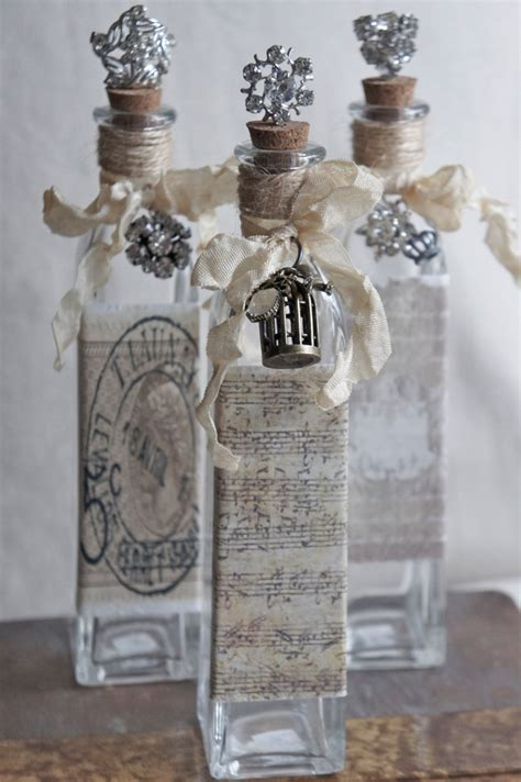 decorative bottle with vintage french accents repurposed bottle via etsy altered pretties