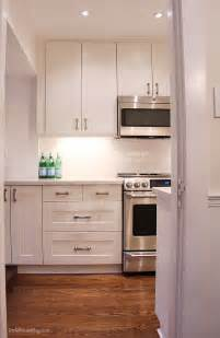 cabinets white subway tiles and house on