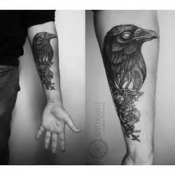 The belt crow tattoo by positive tattoo is dark and moody very good