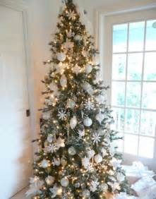 Traditional christmas tree with all white decorations and sparking