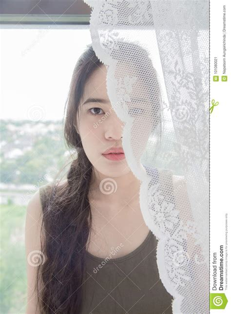 woman behind the curtain woman is behind the curtain stock photo image 101080021