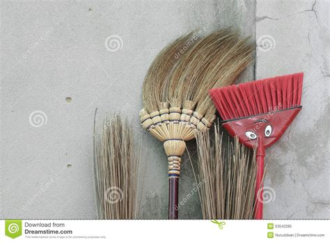 to stick photos on wall brooms stick on brick wall stock image image of garbage