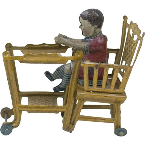 Antique Baby High Chair by 1910s Antique German Lithographed Tin Baby In A High