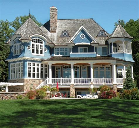 a blue white lake house in wisconsin hooked on houses