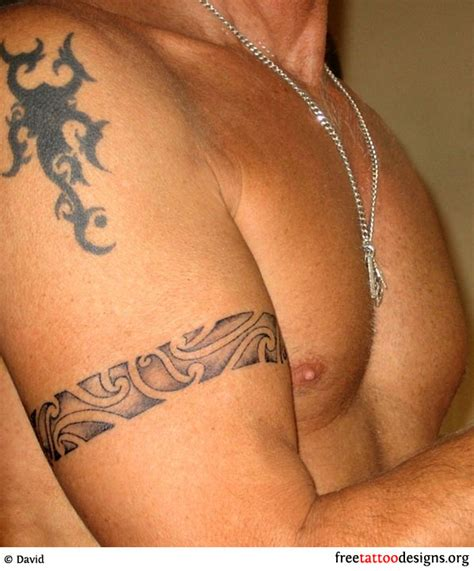 tribal arband tattoo around a man s biceps