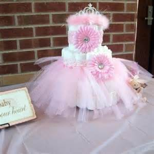 pink and brown baby shower cake decorated with a