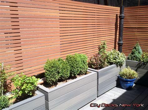 Trex Planter Box by Composite Thin Slat Fence Planter Boxes By City Decks
