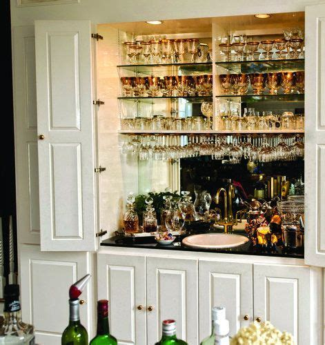 Wet bar hidden behind cabinet doors   add a lock and key