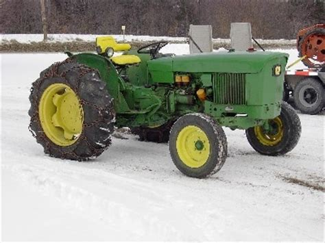 john deere 820 (dad had me rake the hay with this baby