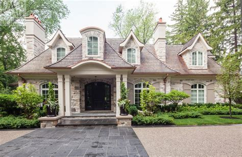 French Country Wall Sconces Dormers Stone Accents Above Windows With Shutters