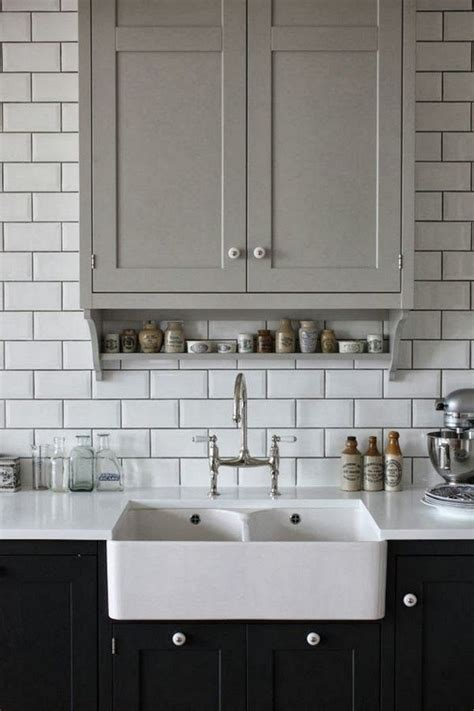 White Tiles With Grey Grout Kitchen by Darker Lower Kitchen Cabinets Yay Or Nay Toni Schefer