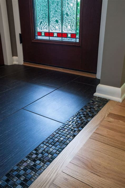 wisconsia tile transitioning from a wood floor into a tile foyer can sometimes be blunt wi new
