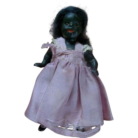 black bisque antique doll all bisque black antique doll with glass and boo boo
