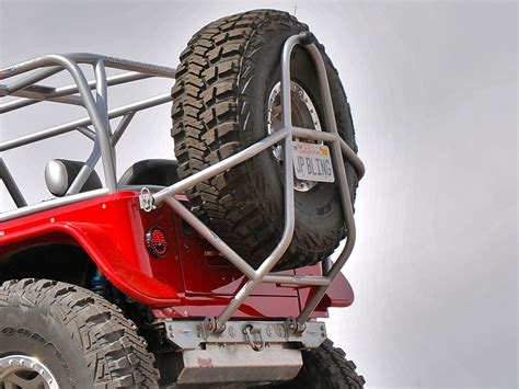 swing down tj lj swing down rear tire carrier aluminum genright