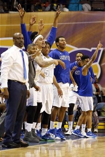 basketball bench cheers johnson leads hton past sc state for meac men s title