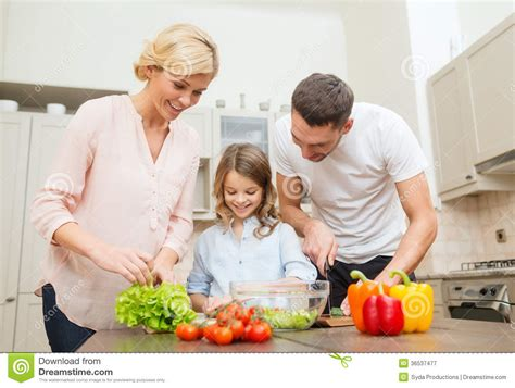 Happy In The Kitchen A Dinner A Signing by Happy Family Dinner In Kitchen Royalty Free Stock
