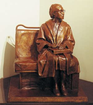 rosa parks statue | a statue of rosa parks sitting on the