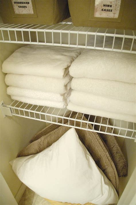 How To Fold Sheets For Linen Closet by How To Fold Fitted Sheets Plus Bathroom Linen Closet