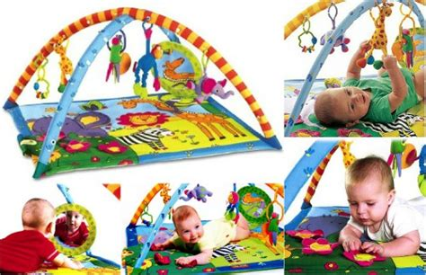 tiny love gymini super deluxe lights music activity gym save 30 on the tiny love super deluxe lights and music gymini