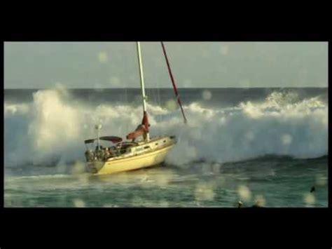 sailing boat in big waves point panic big wave hits sailboat at ala moana bowls in