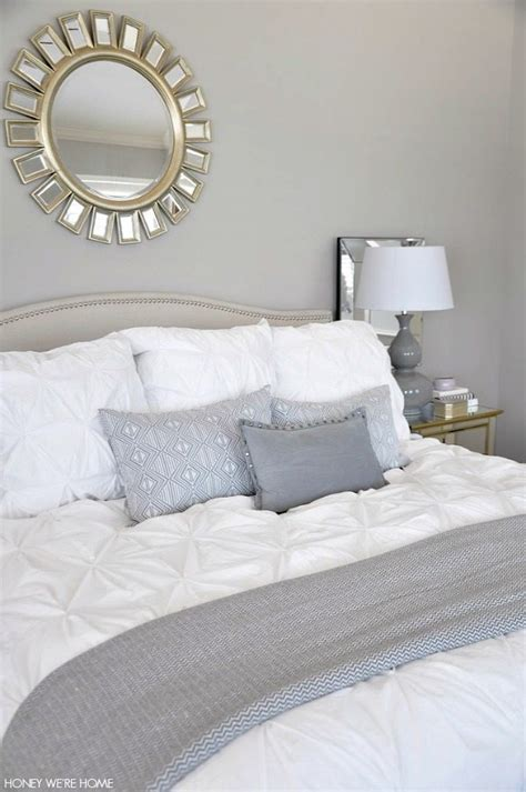 white bedding with accent pillows neutral master bedroom refresh honey we re home