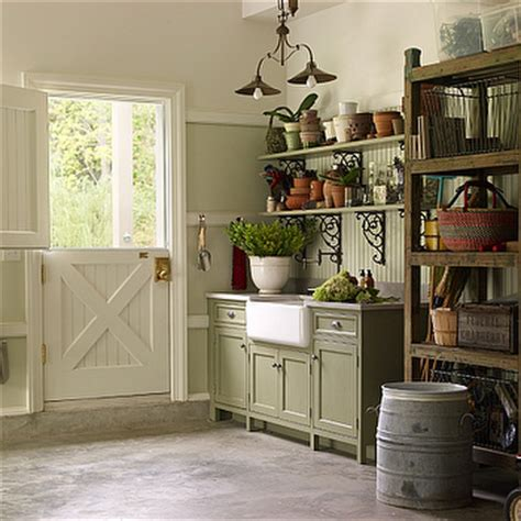 dutch door into kitchen in contrasting color and painted ceiling dutch door country garage kitchens by deane
