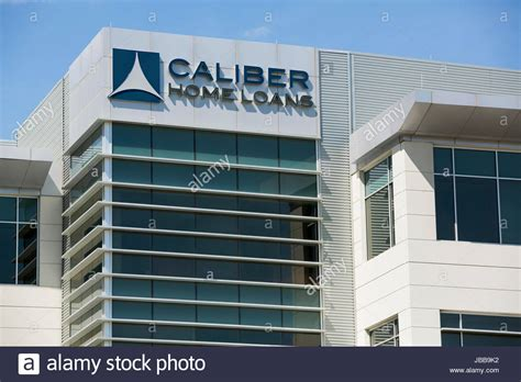 a logo sign outside of the headquarters of caliber home