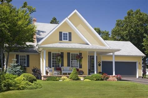 yellow siding houses gray shutters search home