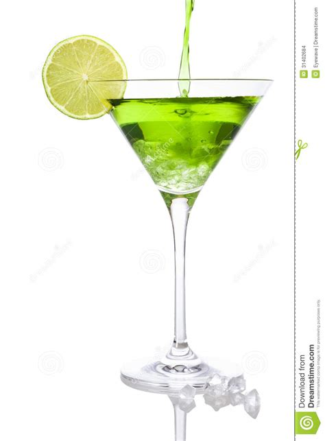 martini green pouring a green cocktail into a martini glass stock photo