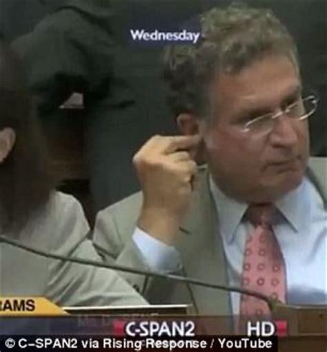 democrat eating ear wax on tv...ugg!