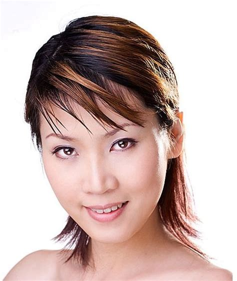 hairstyles for women with big ears long and curly hair highlighted asian women hairstyle with layers in two tones