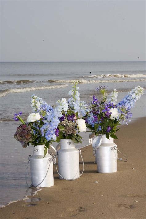 Flowers in milk can lovely for Beach Wedding www