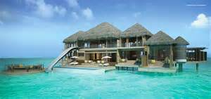 overwater bungalow surfs up in the maldives water the lotto and maldives