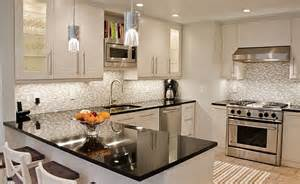black countertop white mosaic backsplash backsplash