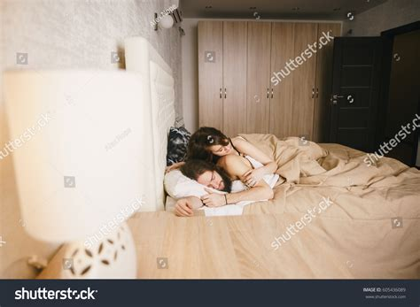 romantic couple images in bedroom side view young romantic couple embracing stock photo 605436089 shutterstock